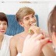 Young couple cleaning teeth. — Stock Photo #4855951