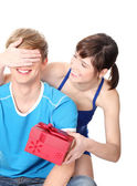 Girl give a gift to her boyfriend. — Stock Photo