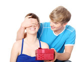 Boy give a gift to his girlfriend. — Stock Photo