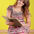 Teen woman reading a book — Stock Photo