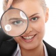 Business woman looking into a magnifying glass — Stock Photo #4864791