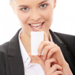 Beautiful businesswoman with business card — Stock Photo #4864834
