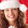 Young woman wearing santa claus hat — Stok fotoğraf