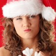 Royalty-Free Stock Photo: Young woman wearing santa claus hat