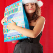 Young woman wearing santa claus hat — Foto Stock
