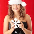 Young woman wearing santa claus hat — Stockfoto