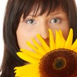 Young woman with a big sun flower — Stock Photo #4865688