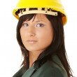 Young female architect or builder wearing a yellow hart hat — Stock Photo #4865958