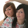 Studio shot of two trendy teen girls — Stock Photo