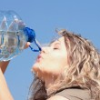Thirsty blond woman on desert — Stock Photo #4866605