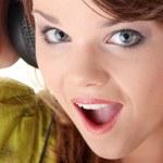 Beautiful teenage girl listening to music — Stock Photo #4867239