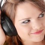 Beautiful teenage girl listening to music — Stock Photo #4867247