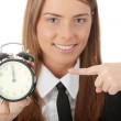 A young woman with alarm clock - Foto Stock