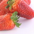Strawberries over white background — Stock Photo