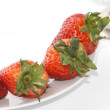 Strawberries over white background - Stock Photo