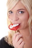 Teenage girl holding red lollipop — Stock Photo