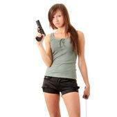 Hermosa chica con una pistola negra — Foto de Stock