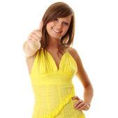 Beautiful brunette girl in yellow dress — Stock Photo