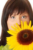 Young woman with a big sun flower — Stock Photo
