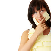 Woman with yellow sticky notes — Stock Photo