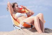 Beautiful blond girl in bikini sunbathing — Stock Photo