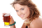 Young woman in bikini drinking ice tea — Stock Photo