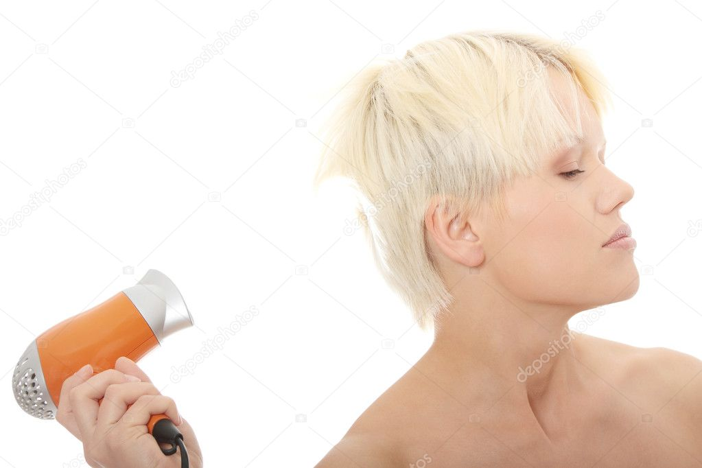 Young blonde woman using hair drier isolated on white — Stock Photo #4865246