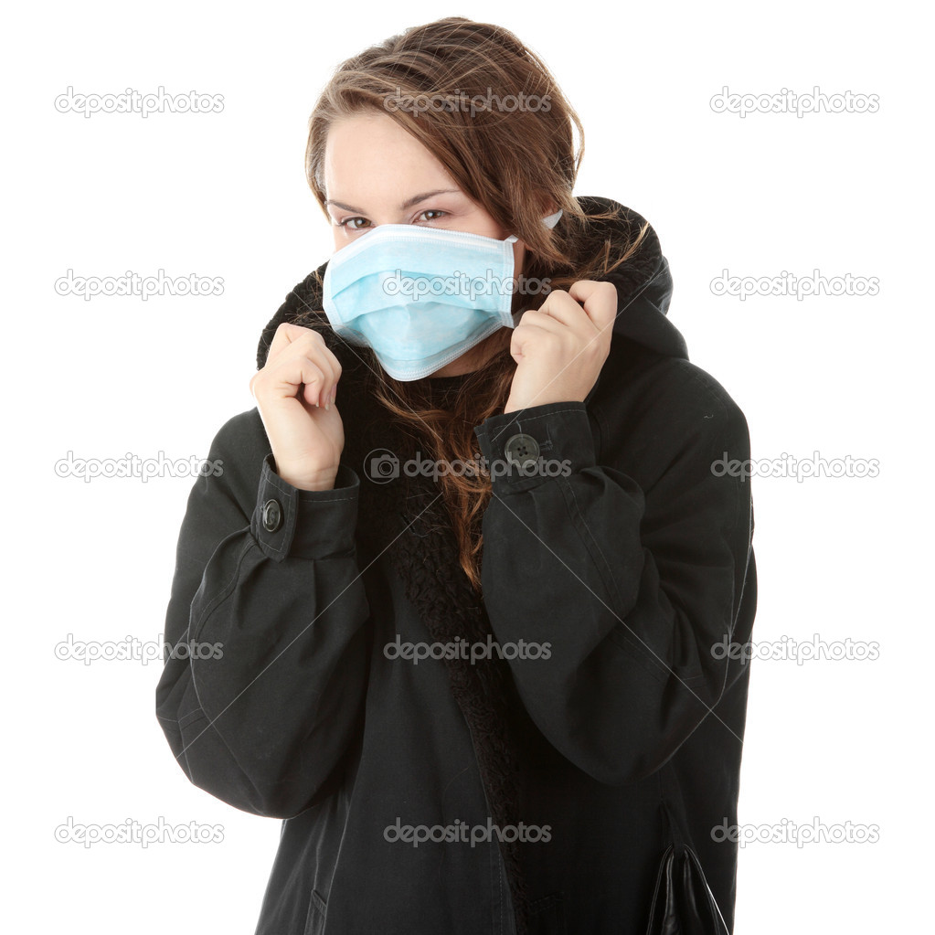 A model wearing a mask to prevent 'Swine Flu' infection. Isolated — Stock Photo #4865539