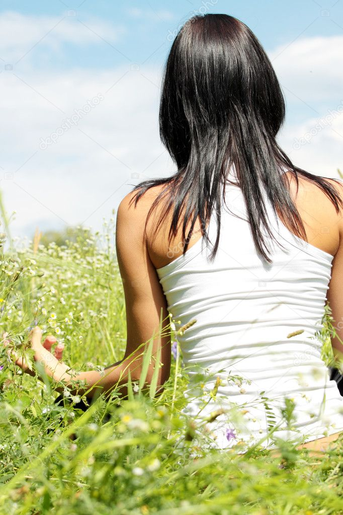 Young woman in pose lotus meditating outdoor. — Stock Photo #4865799