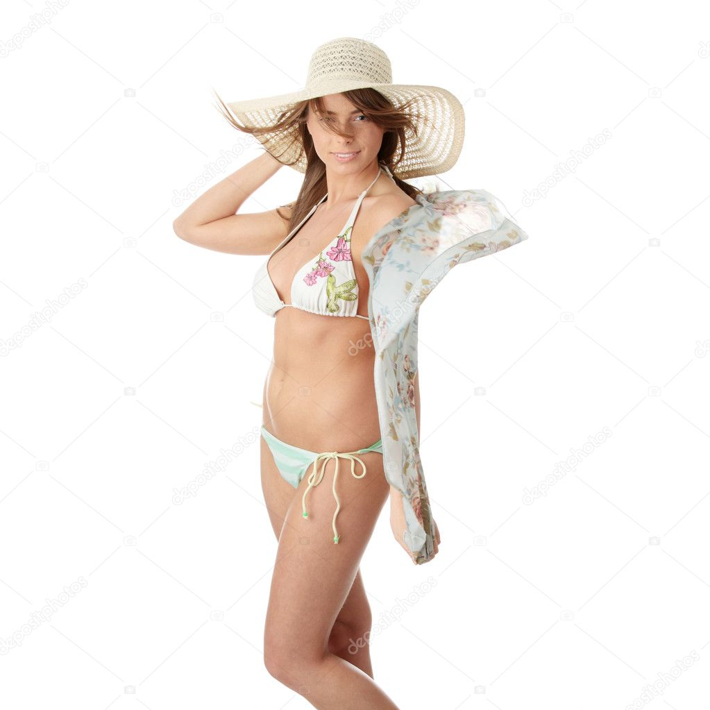 Summer teen girl in bikini and hat, isolated on white background