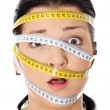 Woman with measuring tape around her head — Stock Photo #4965210