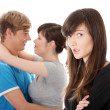 Sad brunette girl jealousy about her friend — Stock Photo #4965250