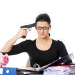 Stock Photo: Female killing her self while filling out tax forms