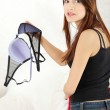 Angry woman with bra in hand. — Stock Photo #4965905