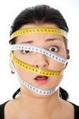 Woman with measuring tape around her head — Stock Photo