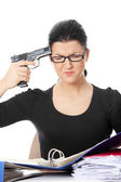 Female killing her self while filling out tax forms — Stockfoto