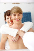 Young happy couple at bathroom. — Stock Photo