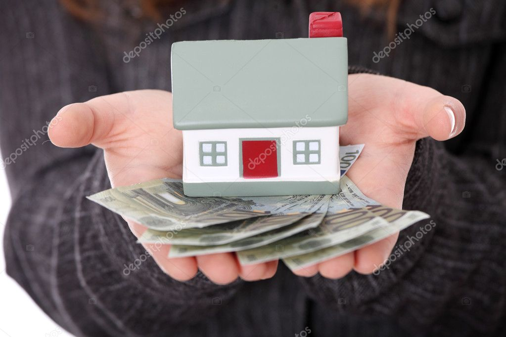 Beautiful young businesswoman holding euros bills and house model over white - real estate loan concept  — Stock Photo #4965329