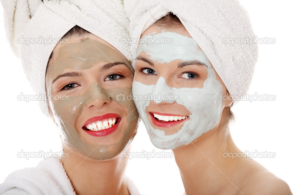 Young happy women with facial clay mask , isolated on white — Stock Photo #4965849