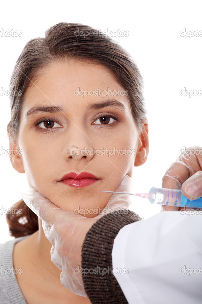 Plastic surgeons giving botox injection in female skin. Isolated on white — Stock Photo #4974846