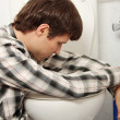 Man vomiting - Stock Photo