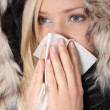 Stock Photo: Woman holding tissue and sneezing