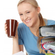 Royalty-Free Stock Photo: Smiling young woman with coffee cup