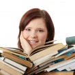 Young woman sitting behind books — Stock Photo