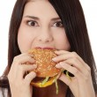 Woman eating hamburger — Stockfoto