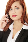 Businesswoman speaking on the phone — Stock Photo
