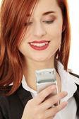 Businesswomen with cellular phone — Stock Photo