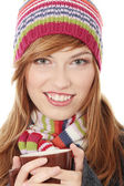 Woman with winter cap drinking something hot — Stock Photo