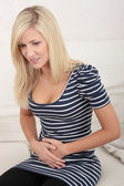 Woman with stomach issues — Stock Photo