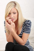 Woman eating her nails becouse of stress — Stock Photo